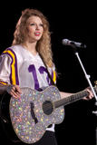http://img9.imagevenue.com/loc493/th_32524_Taylor_swift_performs_her_Fearless_Tour_at_Tiger_Stadium_007_122_493lo.jpg
